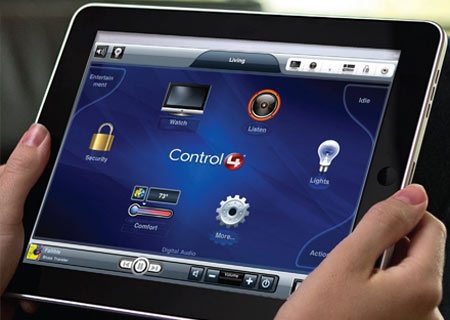 Image of person controlling appliances with ipad